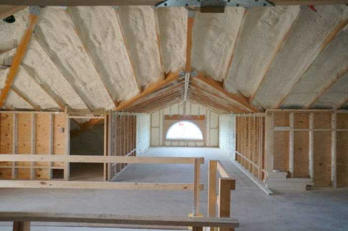 Stick framed attic with open cell insulation